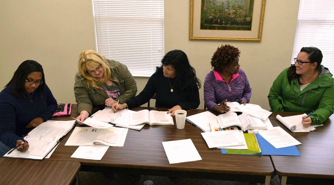 Five Webster University students studying together.