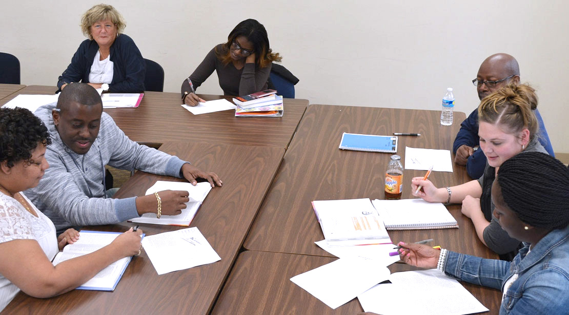 Groups of students completing in-class assignments.