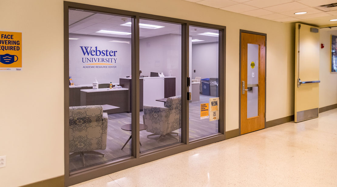 The outer door to Reeg Academic Resource Center with lobby, welcome desk, and two hallways containing computer stations and other resource rooms.