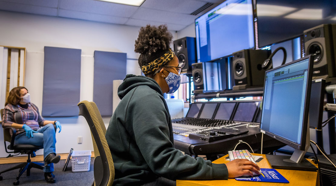 Student using state-of-the-art audio production equipemtn.